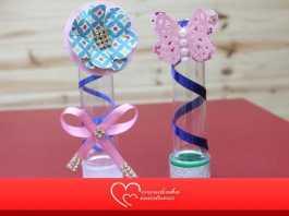 Tubete decorado com borboleta de papel, laço e meia pérola